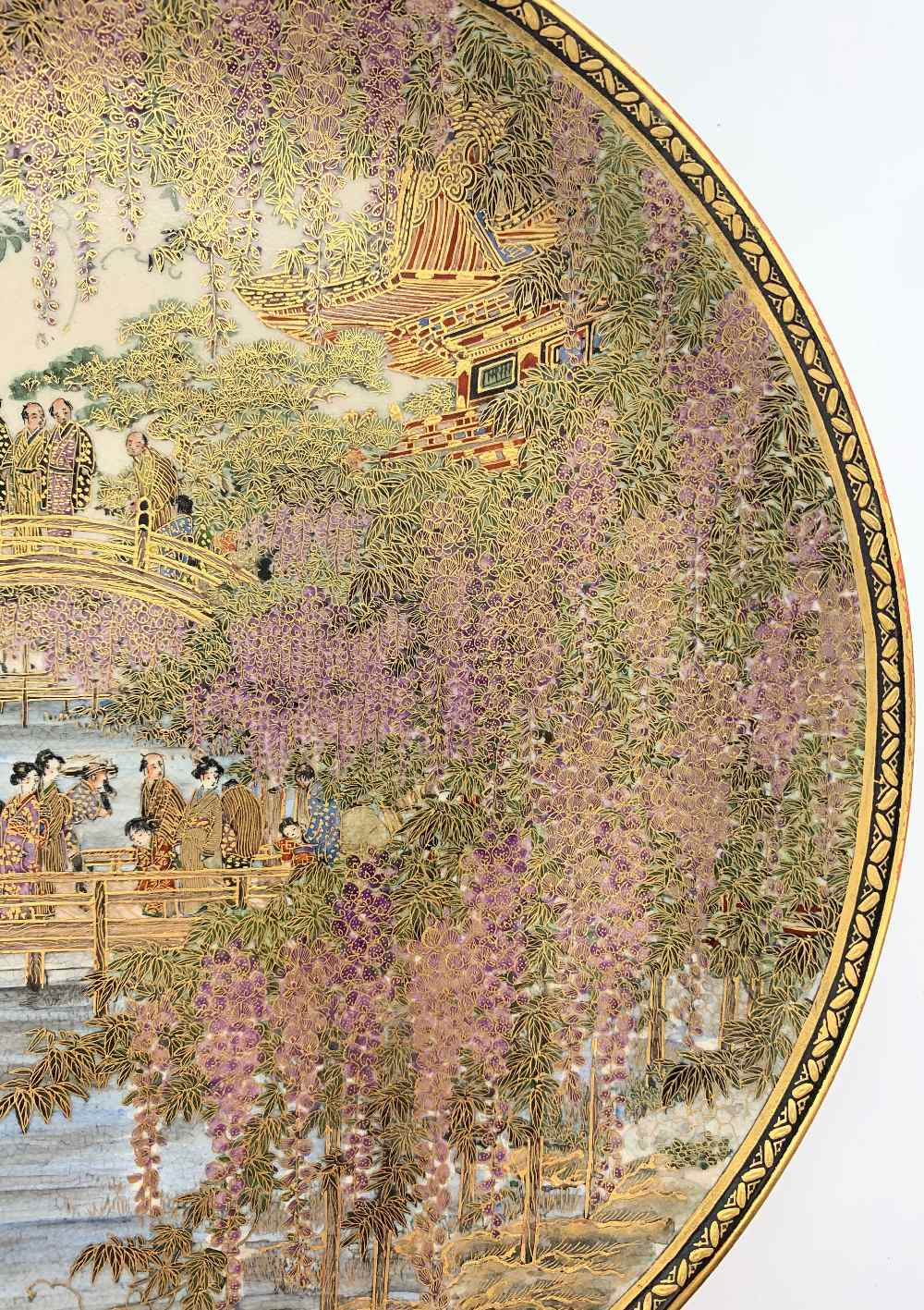 A fine Japanese Meiji period Satsuma plate decorated with figures on a bridge within cascades of - Image 2 of 8