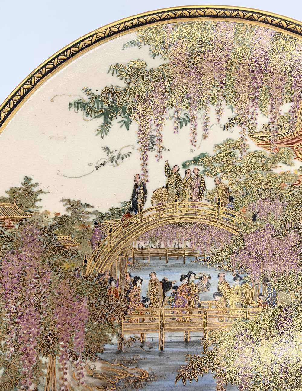 A fine Japanese Meiji period Satsuma plate decorated with figures on a bridge within cascades of - Image 3 of 8