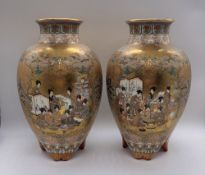 A pair of Japanese Meiji period Satsuma porcelain vases decorated with figures within a textured
