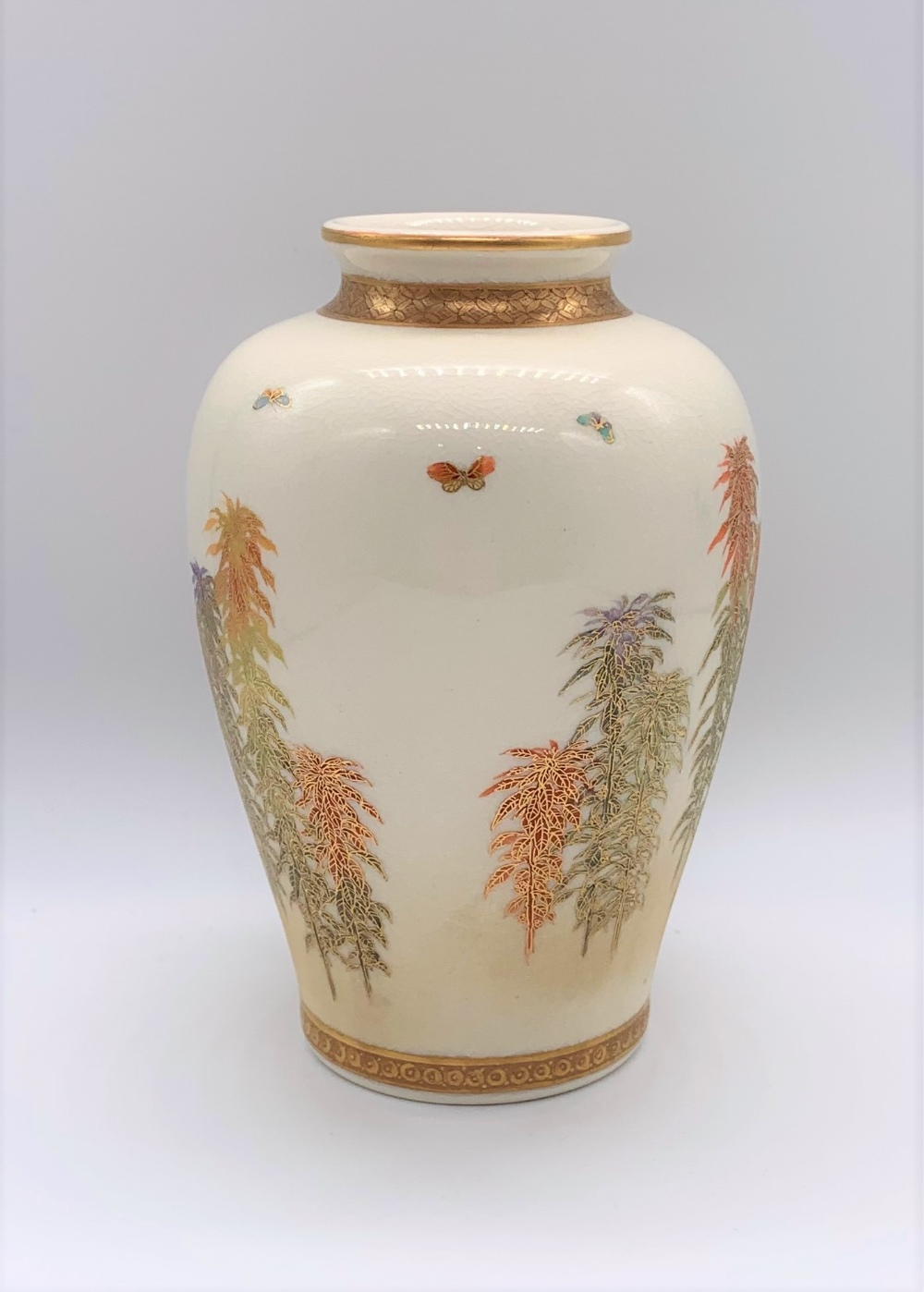KINKOZAN; a Japanese Meiji period Satsuma vase of ovoid form decorated with butterflies above - Image 2 of 9