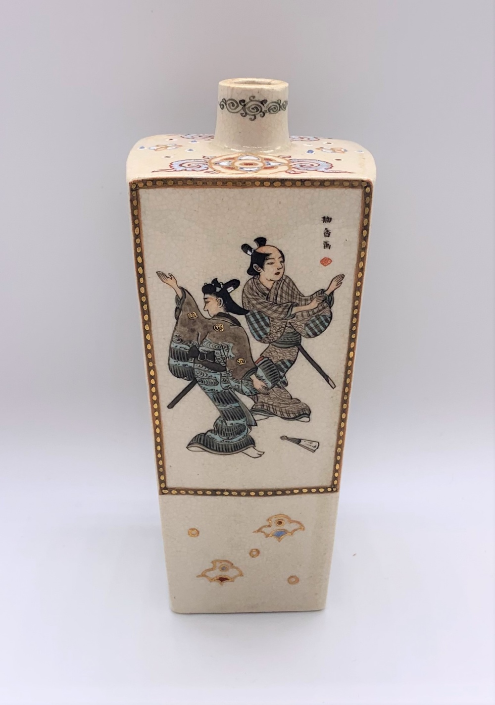 A Japanese Meiji period Satsuma tapering square section vase decorated with figures, butterflies,