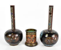 A pair of early 20th century Japanese cloisonné enamel onion vases with elongated necks, decorated