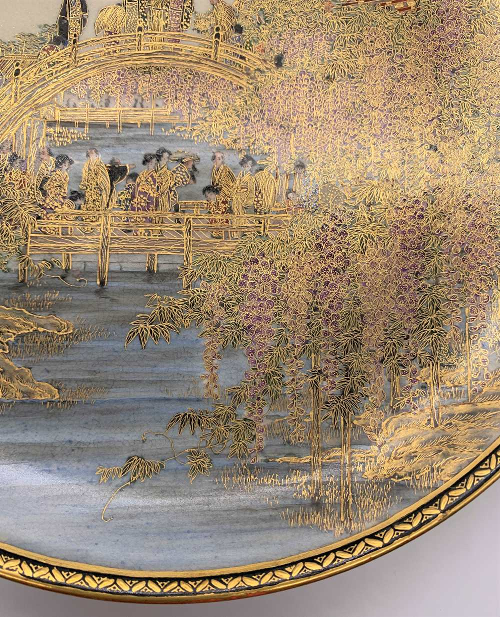 A fine Japanese Meiji period Satsuma plate decorated with figures on a bridge within cascades of - Image 5 of 8