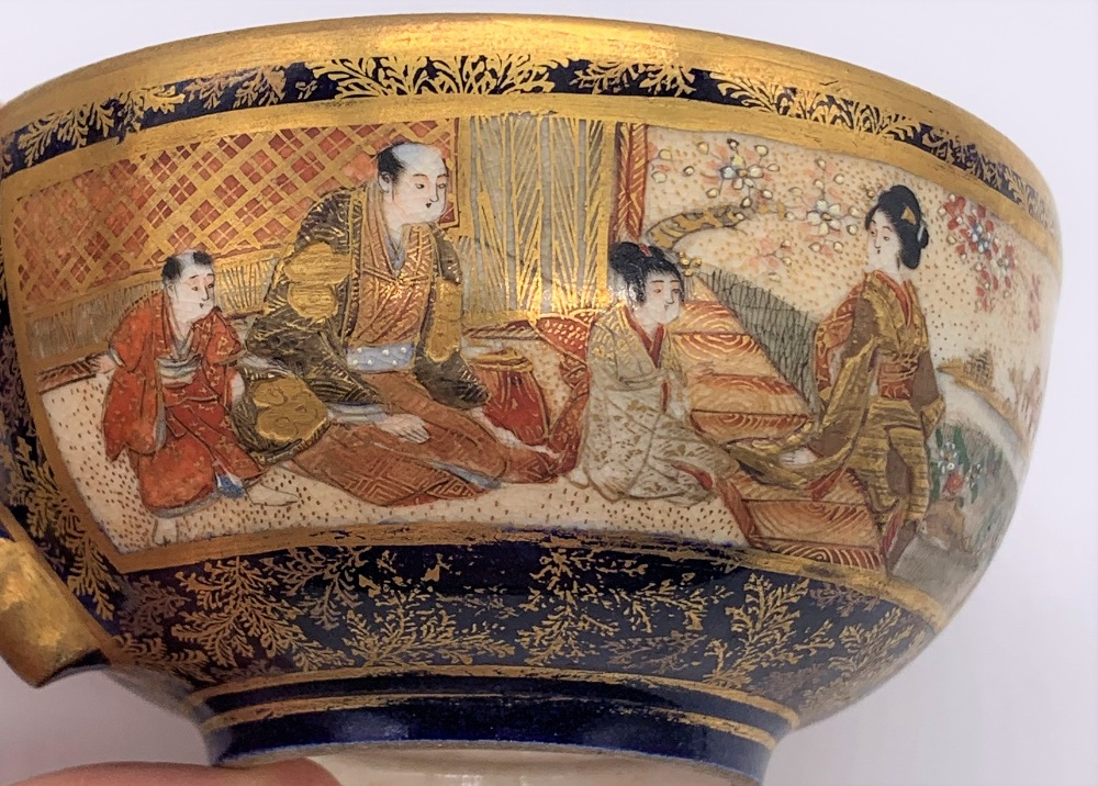 KINKOZAN; a Japanese Meiji period Satsuma cup and saucer decorated with panels of seated figures - Image 6 of 9