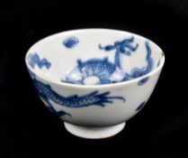 A Chinese blue and white porcelain tea bowl decorated with a four claw dragon, unmarked, height 4.