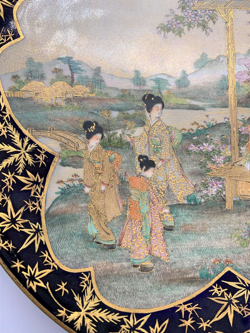 A Japanese Meiji period Satsuma plate with cobalt blue border and central panel of figures with - Image 4 of 8