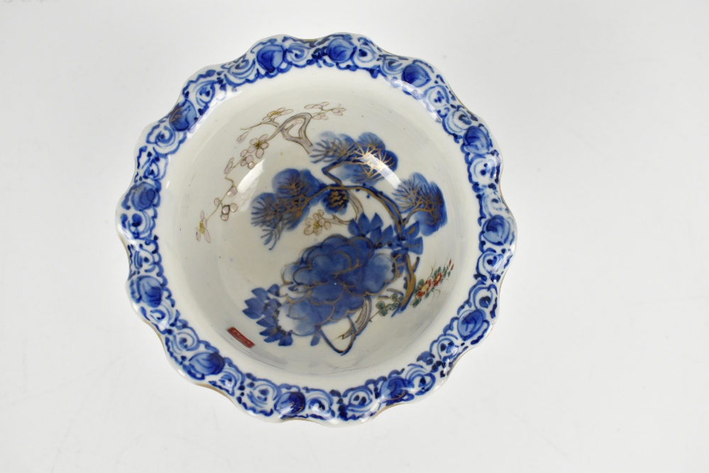 A Japanese porcelain pedestal bowl painted in underglaze blue with floral detail to interior and - Image 3 of 5
