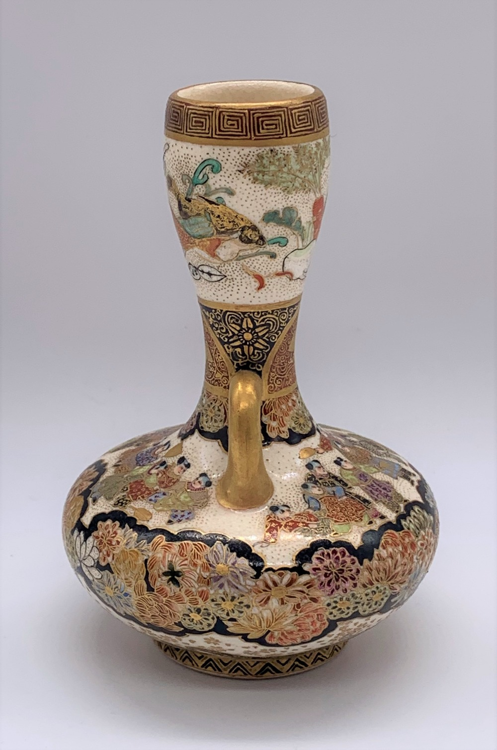 A Japanese Meiji period Satsuma twin handled vase of small proportions decorated with figures and - Image 4 of 7