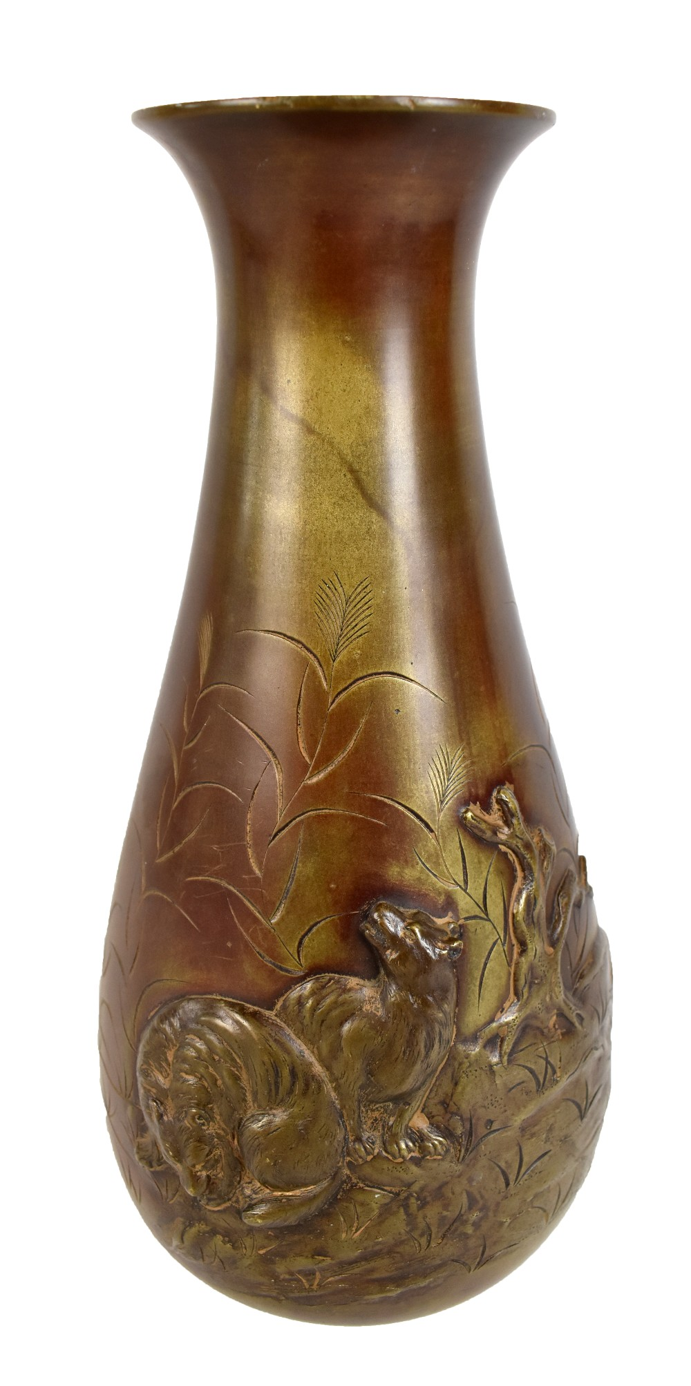 A Japanese Meiji period bronze vase featuring wolves on rocky outcrop in relief against further