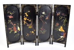 A 1920s Chinese black lacquered and hardstone inset three fold four panel table screen, height 37.