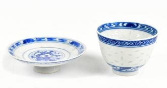 A Chinese 'rice inset' tea bowl painted with a floral spray to the centre and a shallow dish