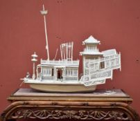 A good mid-19th century Chinese carved ivory junk featuring finely pierced and well modelled