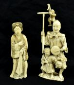 Two Japanese Meiji period carved ivory okimonos, the larger a group featuring man, child and monkey,