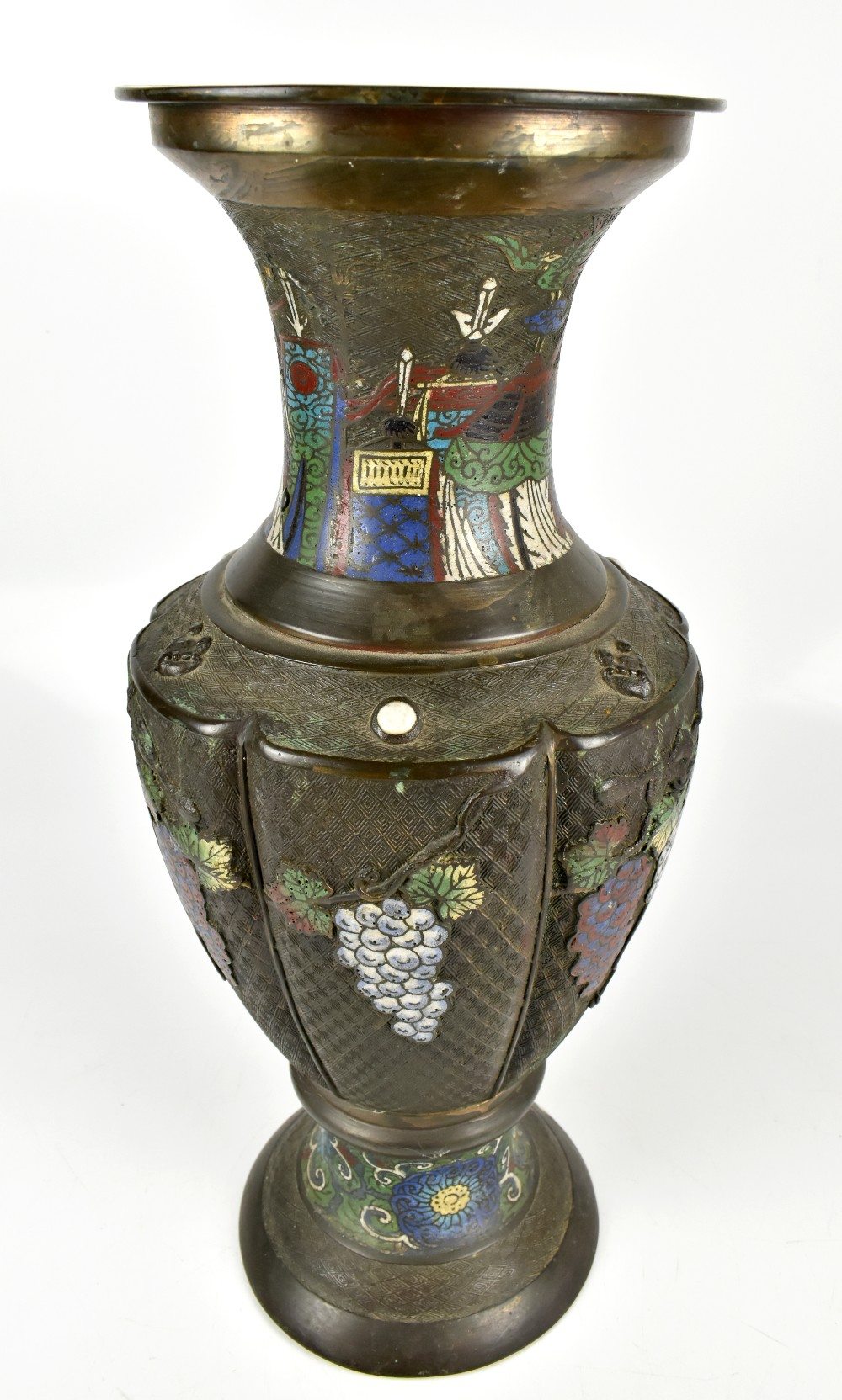 A large Japanese bronze vase with enamelled and relief floral and grape decoration and taotie