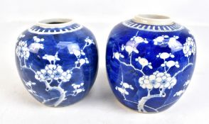 Two similar early 20th century Chinese blue and white prunus decorated jars, height 14cm and 13cm,