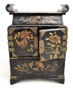 An early to mid-20th century Japanese lacquered jewellery cabinet with an arrangement of two drawers