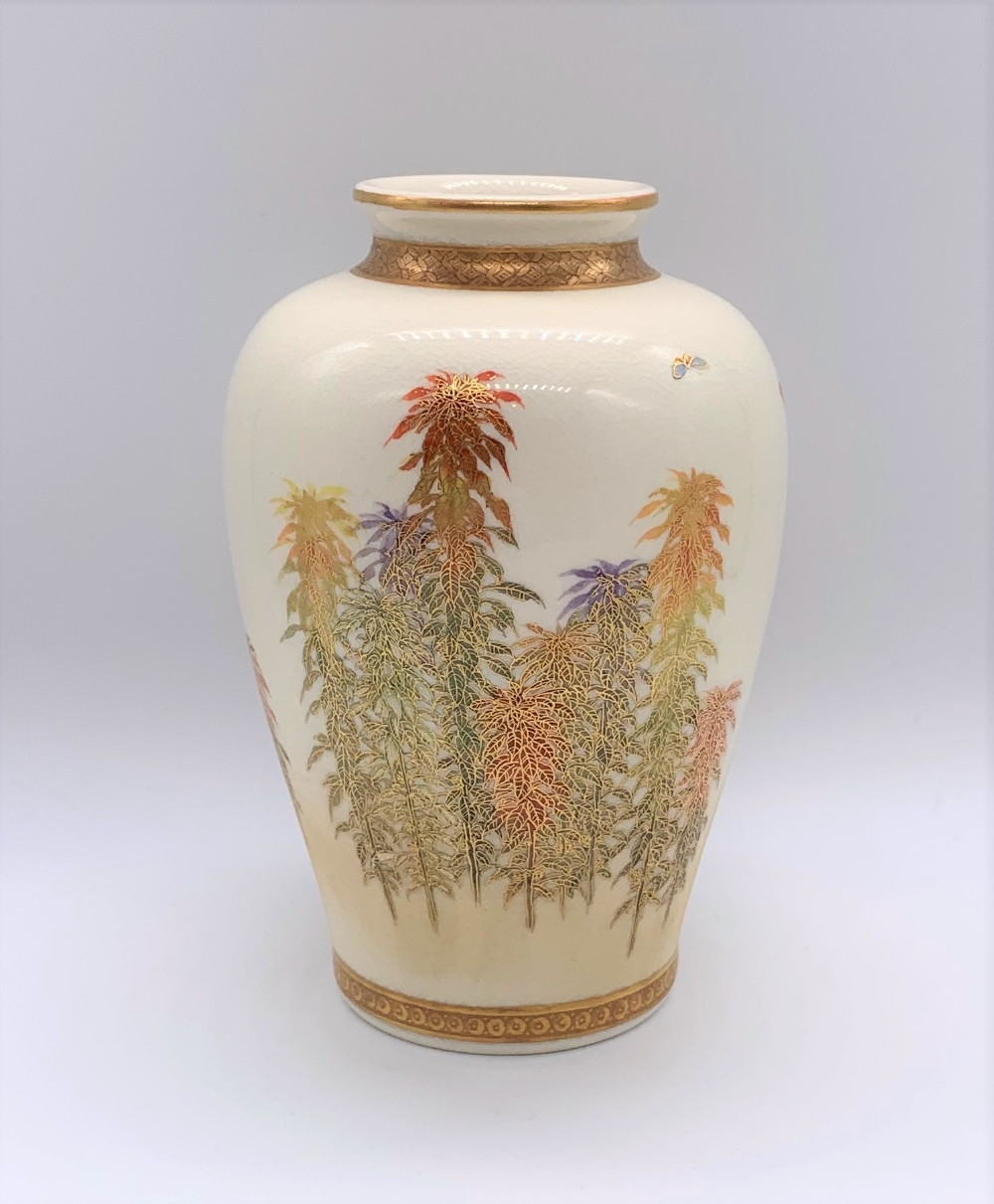 KINKOZAN; a Japanese Meiji period Satsuma vase of ovoid form decorated with butterflies above