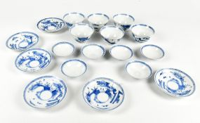 A Japanese blue and white porcelain six setting tea bowl, saucer and cover service, painted with