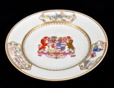 An 18th century Chinese export porcelain armorial plate with central crest inscribed 'Essayez Quid