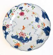 An 18th century Chinese porcelain unfinished Tobacco Leaf pattern plate with enamelled detail and
