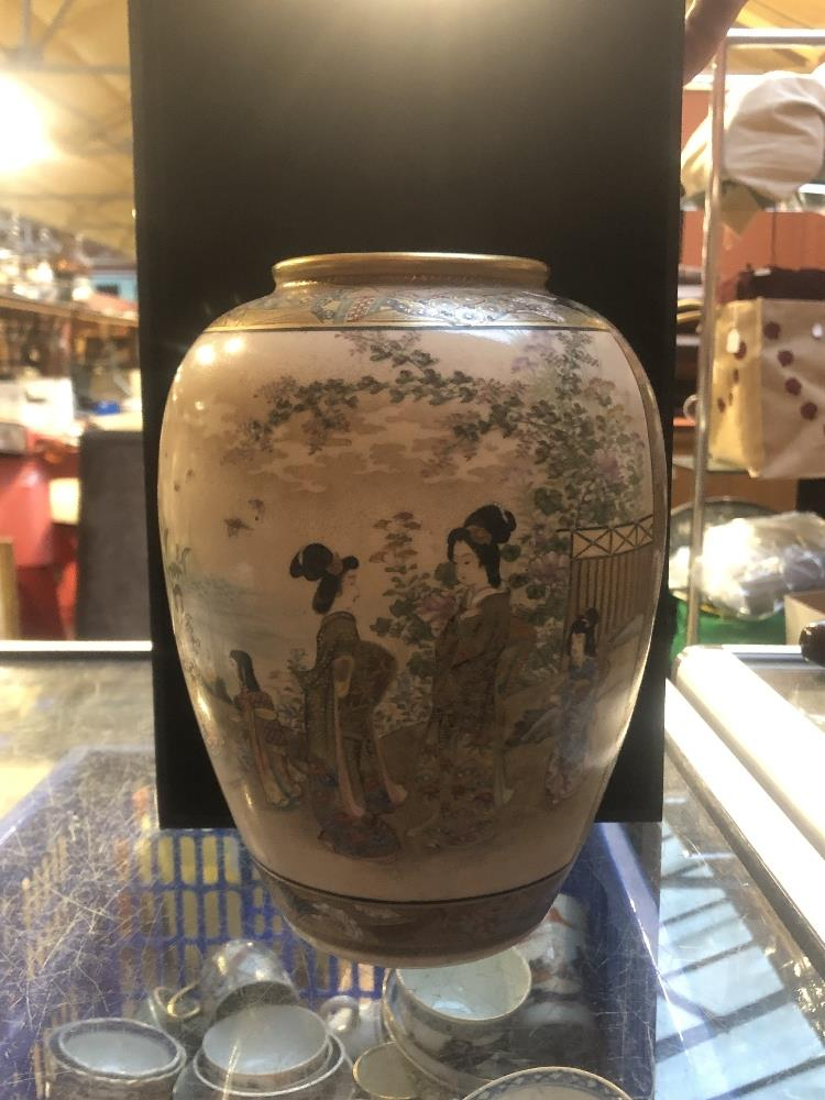 A Japanese Satsuma vase of globular form painted with geishas inside floral panels, signed to - Image 6 of 7