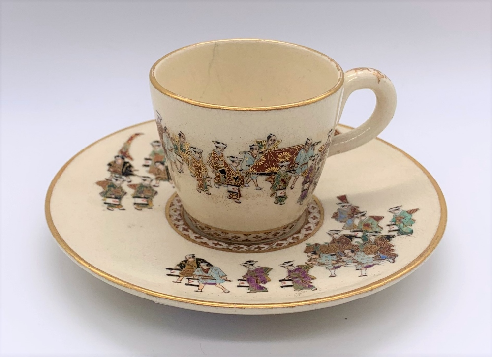 KINKOZAN; a Japanese Meiji period Satsuma cup and saucer decorated with a procession and with