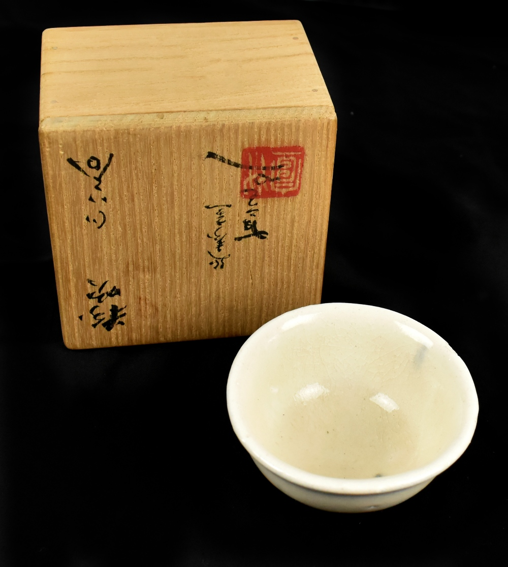 An early 20th century Japanese shino ware 'winter' chawan with impressed mark, diameter 6.7cm, in