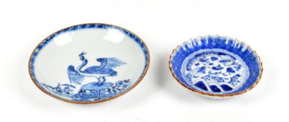 A Chinese blue and white porcelain saucer decorated with a crane swallowing a fish, diameter 11.