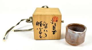 An early 20th century Japanese Shino ware 'winter' chawan with impressed mark, height 4.9cm, in
