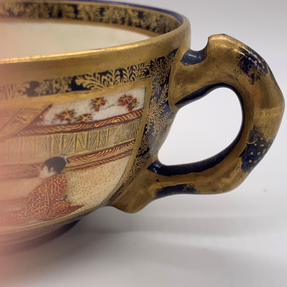 KINKOZAN; a Japanese Meiji period Satsuma cup and saucer decorated with panels of seated figures - Image 7 of 9