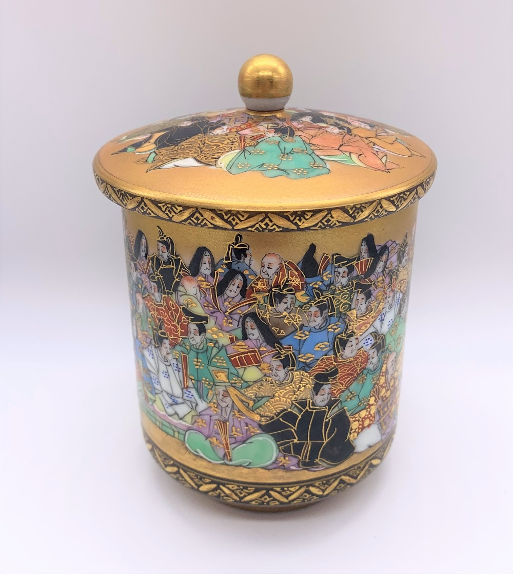 An unusual Japanese Meiji period Satsuma porcelain pot and cover painted with a band of figures,