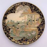 A Japanese Meiji period Satsuma plate with cobalt blue border and central panel of figures with