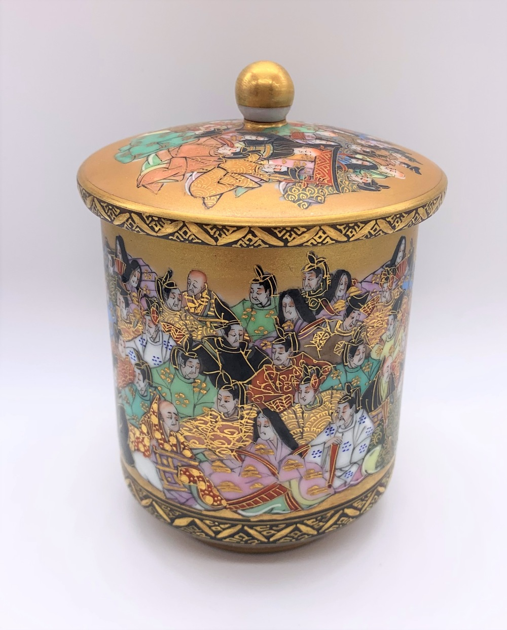 An unusual Japanese Meiji period Satsuma porcelain pot and cover painted with a band of figures, - Image 2 of 10