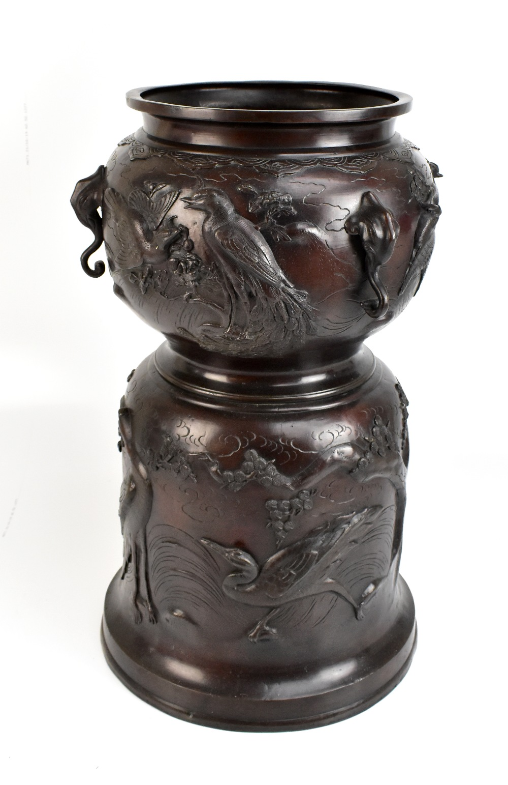 A good and large Japanese Meiji period bronze jardinière and stand cast in one, profusely