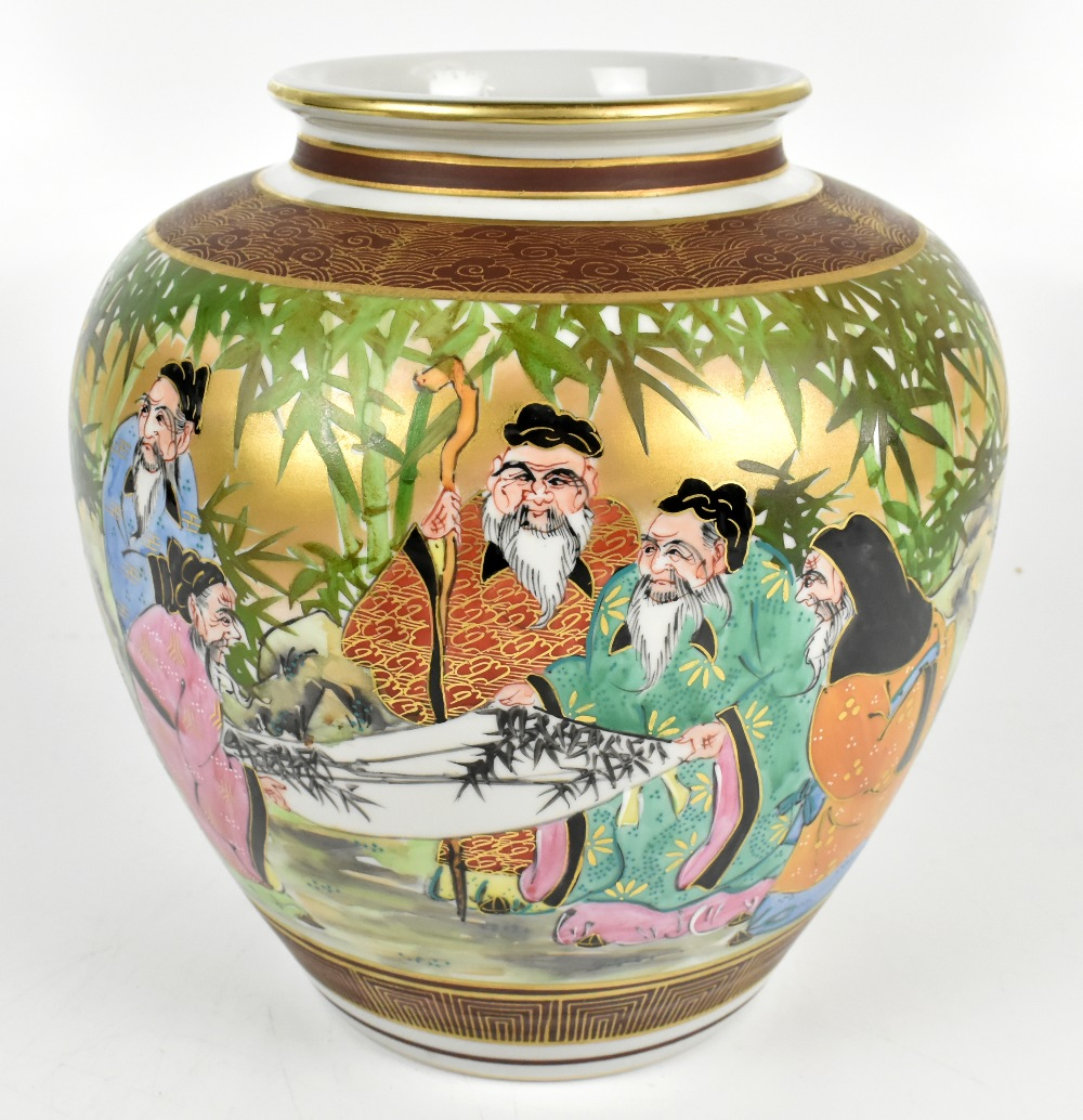 A large Japanese porcelain vase painted with scholars admiring a painting in bamboo grove setting,