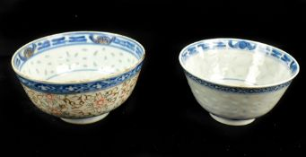 Two Chinese 'rice inset' bowls both with painted four character Kangxi marks to base, diameter 10.