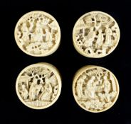 A set of four early to mid-19th century Chinese Canton carved ivory counter boxes with screw-off