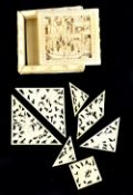 A mid-19th century Chinese Canton carved ivory puzzle box of square form with sliding lid
