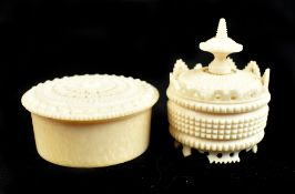 A mid-19th century Chinese Canton carved ivory circular gaming box and cover containing seven