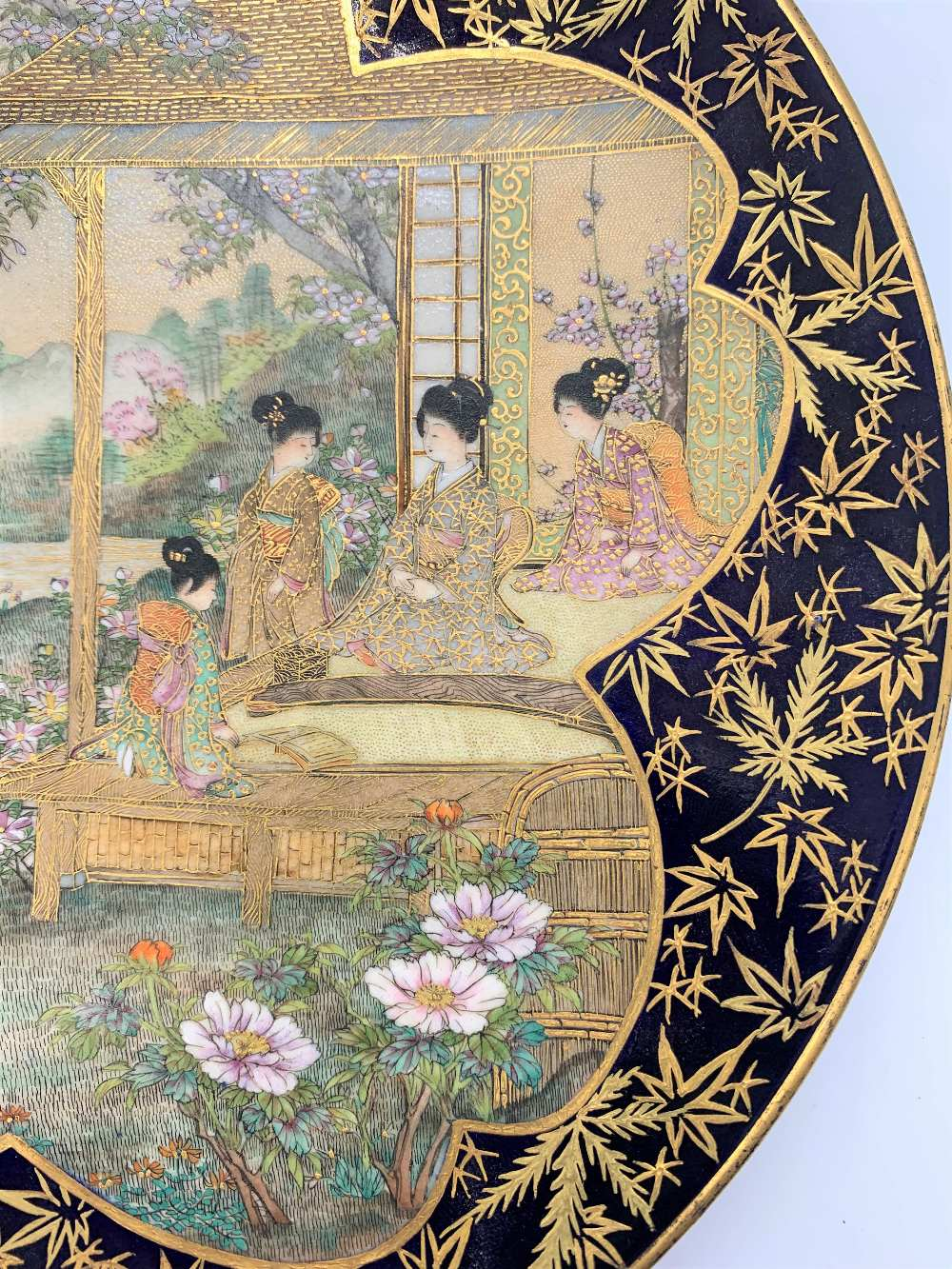 A Japanese Meiji period Satsuma plate with cobalt blue border and central panel of figures with - Image 3 of 8