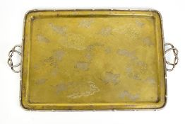 A Japanese Meiji period mixed metal tray with inlaid and engraved decoration of stylised phoenix and