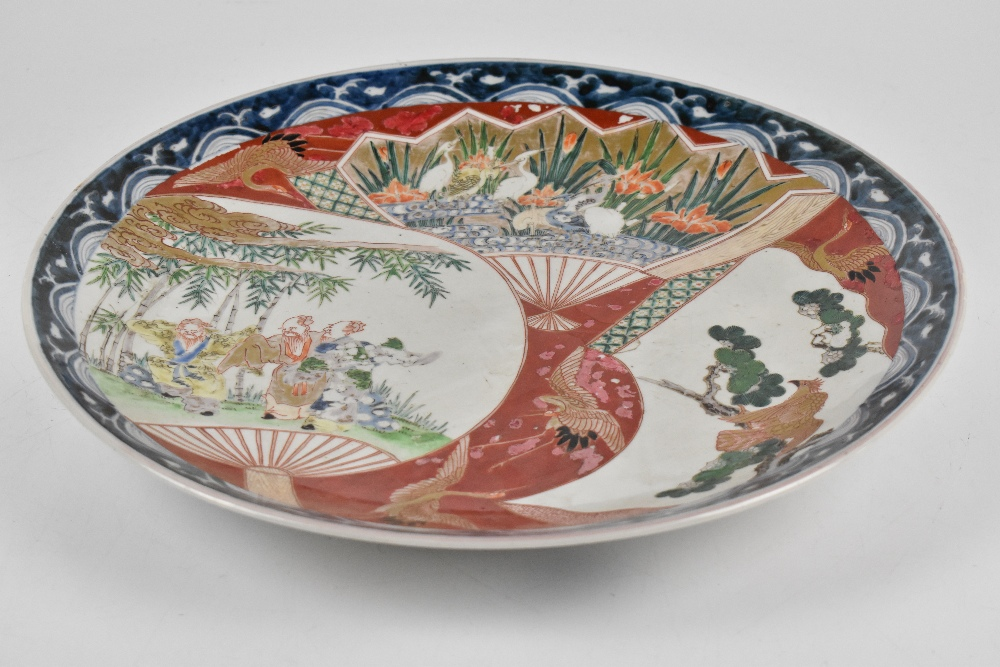 A Japanese Meiji period Imari wall charger painted with figures in landscape setting, diameter - Image 3 of 3