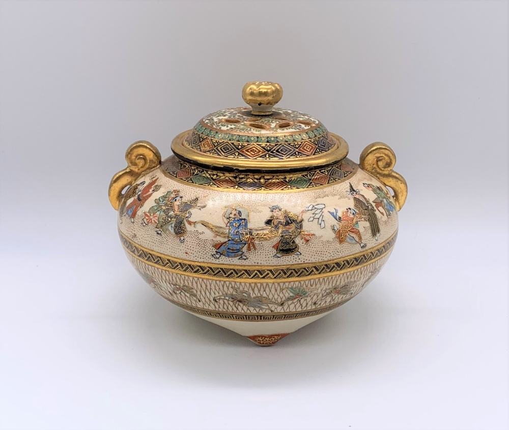 A Japanese Meiji period Satsuma koro of circular form with pierced cover above twin moulded gilt