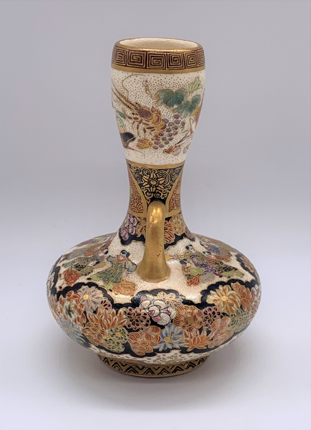 A Japanese Meiji period Satsuma twin handled vase of small proportions decorated with figures and - Image 2 of 7