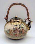 HOZAN; a good Japanese Meiji period Satsuma miniature teapot with rattan handle and figural