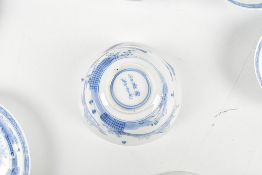 A Japanese blue and white porcelain six setting tea bowl, saucer and cover service, painted with - Image 5 of 5
