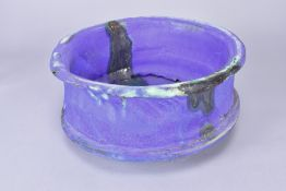 ASHLEY HOWARD (born 1963); a large stoneware bowl covered barium blue and purple glaze, impressed AH