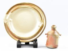 BEN BRIERLEY (born 1964); a wood fired stoneware platter, impressed mark, diameter 32cm, and a small