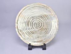 AKIKO HIRAI (born 1970); a stoneware platter covered in pale grey glaze with pink blushes,