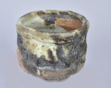 CHARLES BOUND (born 1939); a wood fired stoneware teabowl, impressed marks, height 10cm.Additional